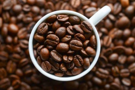 coffee grains in a white mug