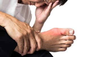 Man experiencing big toe and foot pain from gout